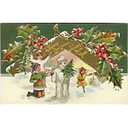 Embossed Nash 1910 Christmas Postcard of Children Building Snowman