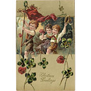 Embossed PFB 1908 Christmas Postcard with Three Children