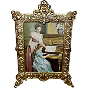 Cast Iron Easel Back Frame with Music Parlor Scene