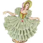 Lady in Green Porcelain Lace Figurine with Crown Mark