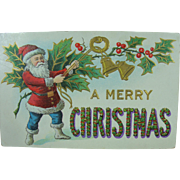 A Very Merry Christmas Santa in Blue Pants Post Card Early 20th Century