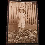 Photo Barefoot Child Sunsuit Bonnet Picket Fence