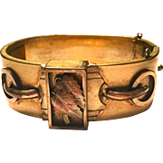 Antique Victorian hinged bangle bracelet with raised relief rose gold leaf and buckle motif decoration