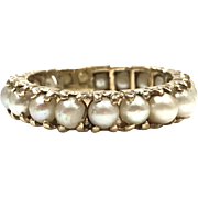 Vintage 1960s 14 karat Yellow Gold Round Pearl Infinity Band Ring