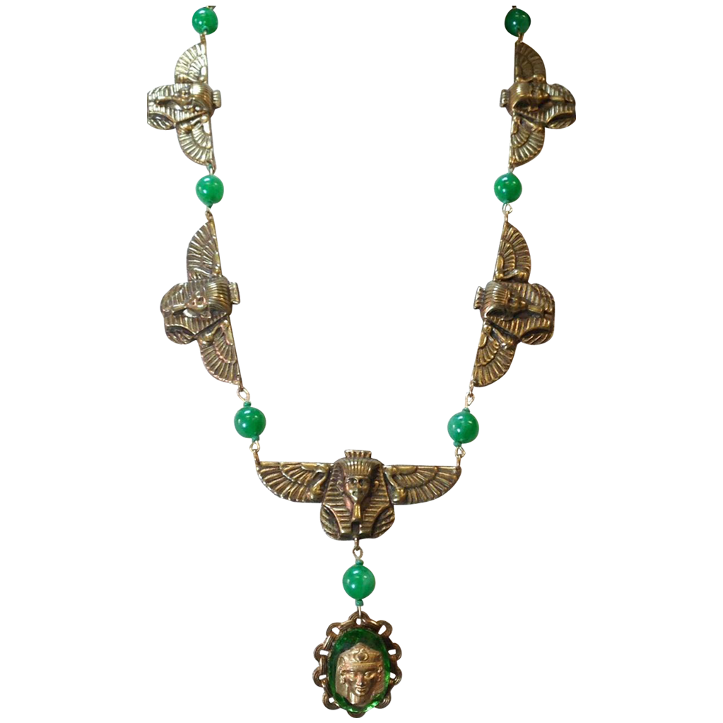 Egyptian design Gold Tone with small green plastic beads and Large glass pendent