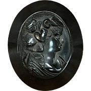 Very large antique Victorian carved black jet cameo pin brooch with possible gutta percha bog oak wood border