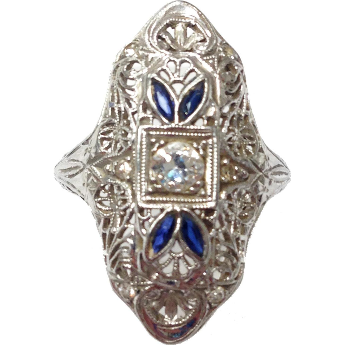Art Deco filigree dinner Ring  of 18k white gold .25 carat diamond and sapphires