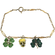 Vintage Bracelet made of 14k Gold Watch Chain with enamel Four leaf Clover and pansy Charms