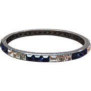 Vintage Art Deco Marked Sterling channel set blue Sapphire colored and clear crystal rhinestone hinged bangle bracelet