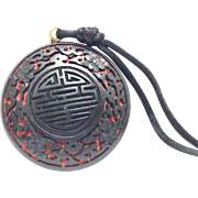 Vintage carved cinnabar black lacquer circular Chinese pendant