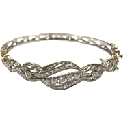 Vintage 1960s White Gold and Yellow Gold Hinge Bangle Bracelet with Sparkling Diamonds