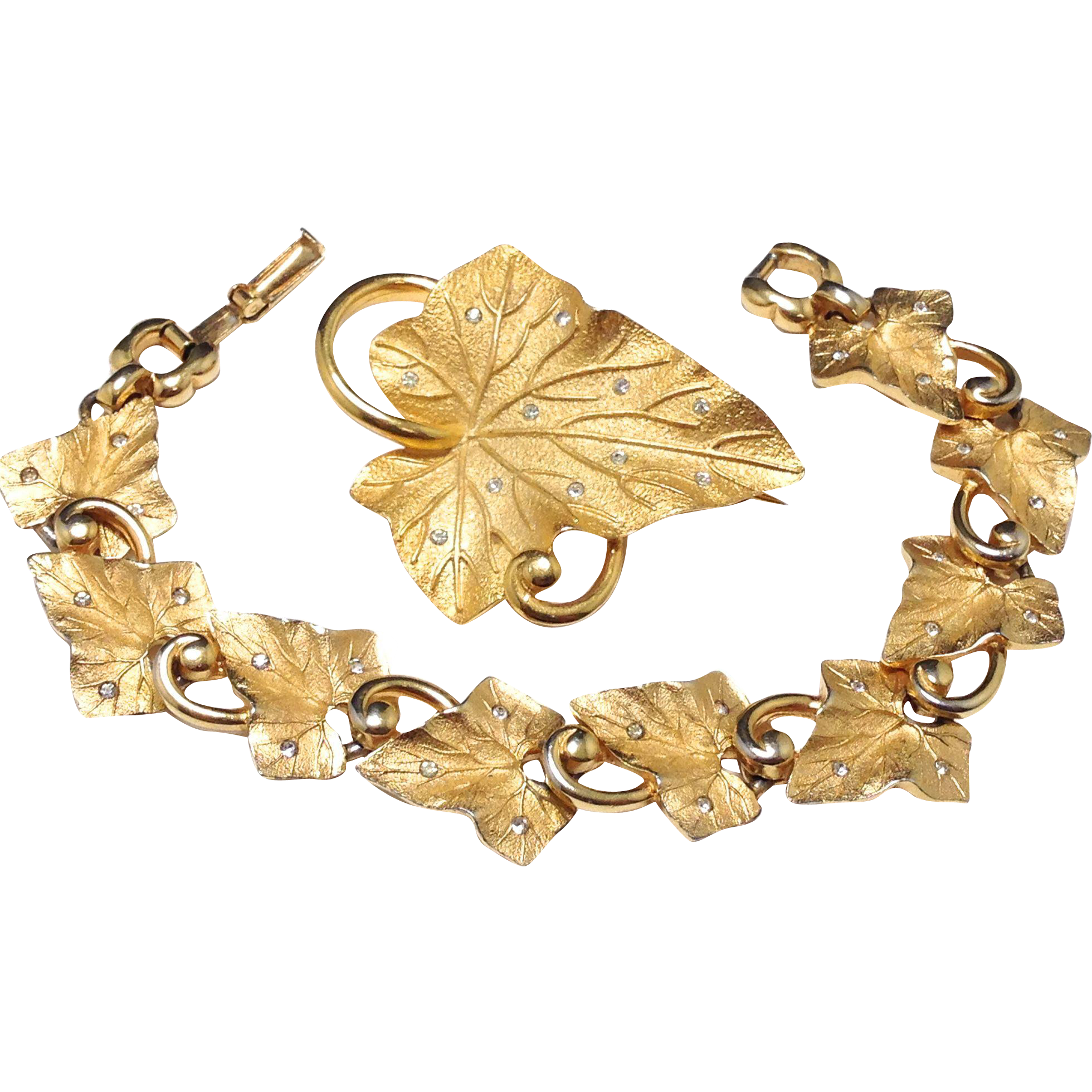Vintage Pennino signed gold tone leaf bracelet and brooch set