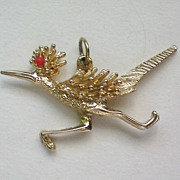 Gold tone Road Runner Pendant