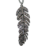 Articulated Silver Tone Indian Feather Rhinestone Pendant Necklace