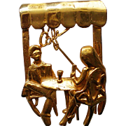 Figural Pin with Diners in a Café