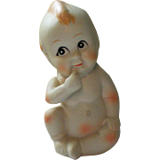 Bisque Sitting Kewpie Baby Figurine