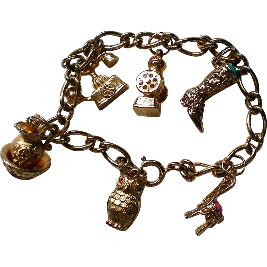 Avon Charm Bracelet with 6 Charms in Gold tone Metal