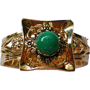 Gold tone Metal Hinged Bangle Bracelet with Jade Green Cabochon