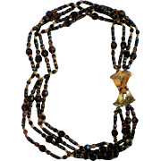 Hattie Carnegie Four Strand Glass Bead Necklace with Floral Clasp