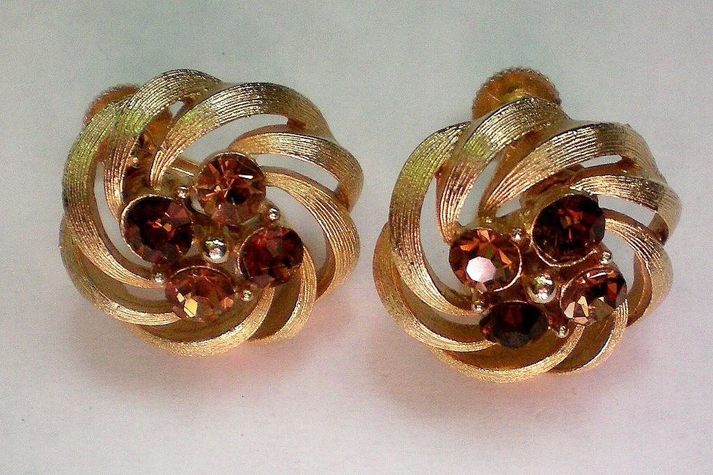 Signed Lisner Gold Tone Amber Rhinestone Swirl Earrings