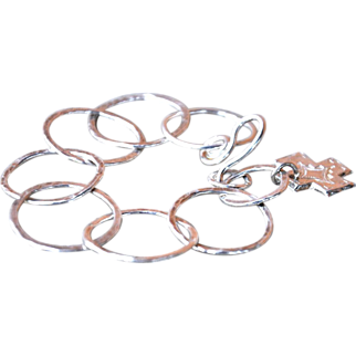 Hand-Fused Fine Silver Circle Bracelet with a Cross Charm