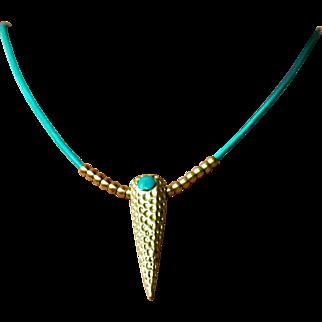Striking Brass Pendant on Greek Leather