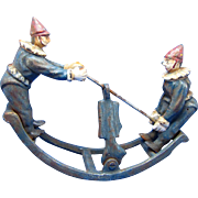 Collectible Doorstop of Rocking Pierrot Clowns on See-Saw, Cast Iron