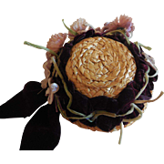 Small Straw Hat Decorated with Burgundy Ribbon and Old Flowers