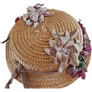 Old Straw Hat Decorated with Old Flowers and Ribbon