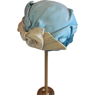 Small Straw Hat Covered in Blue Silk and Velvet