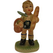 Napcoware Boy with Bread Figurine