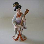 Oriental Woman Playing Instrument Figurine