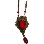 Opulent 1930 Stamped Brass And Ruby Glass Pendant Necklace