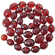 """31 Inch Graduated Strand Of Faceted Cherry Amber """"Prystal"""" Bakelite"""