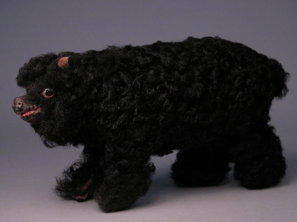 "8"" Long black Lambskin Covered Paper Mache Bear Cub"