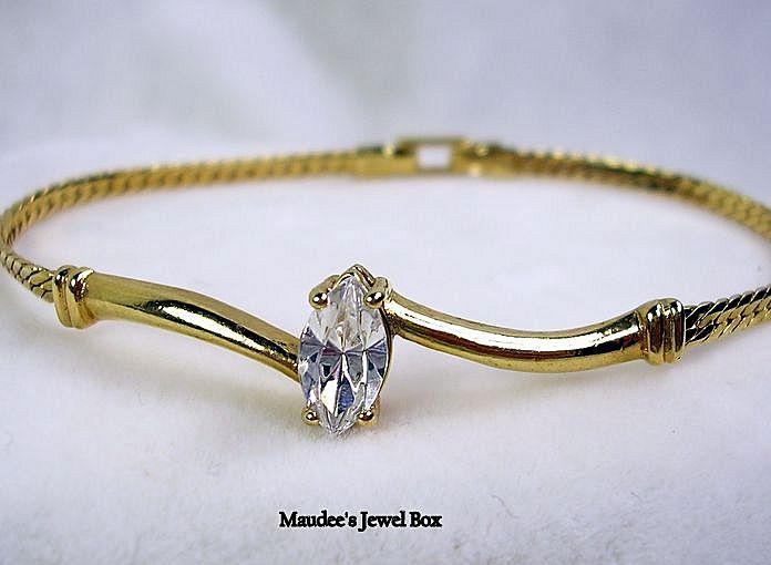 Signed Avon Gold Tone Marquise Crystal Rhinestone Bracelet