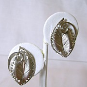 Vintage Clip Earrings with Leaf and Cutout Design in Silver Tone