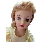 Ideal Miss Revlon VT-18 Vinyl Doll with Pierced Ears and Yellow Rayon Dress
