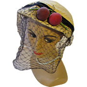 Straw Hat in Maize Tone Straw with Purple Red Crab Apples and Navy Chin Length Veil