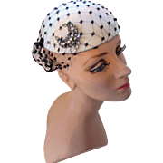 Sophisticated Cocktail Hat in Silky White with Black Veil and Rhinestone Decoration Betmar Marshall Field & Co Hat Bar