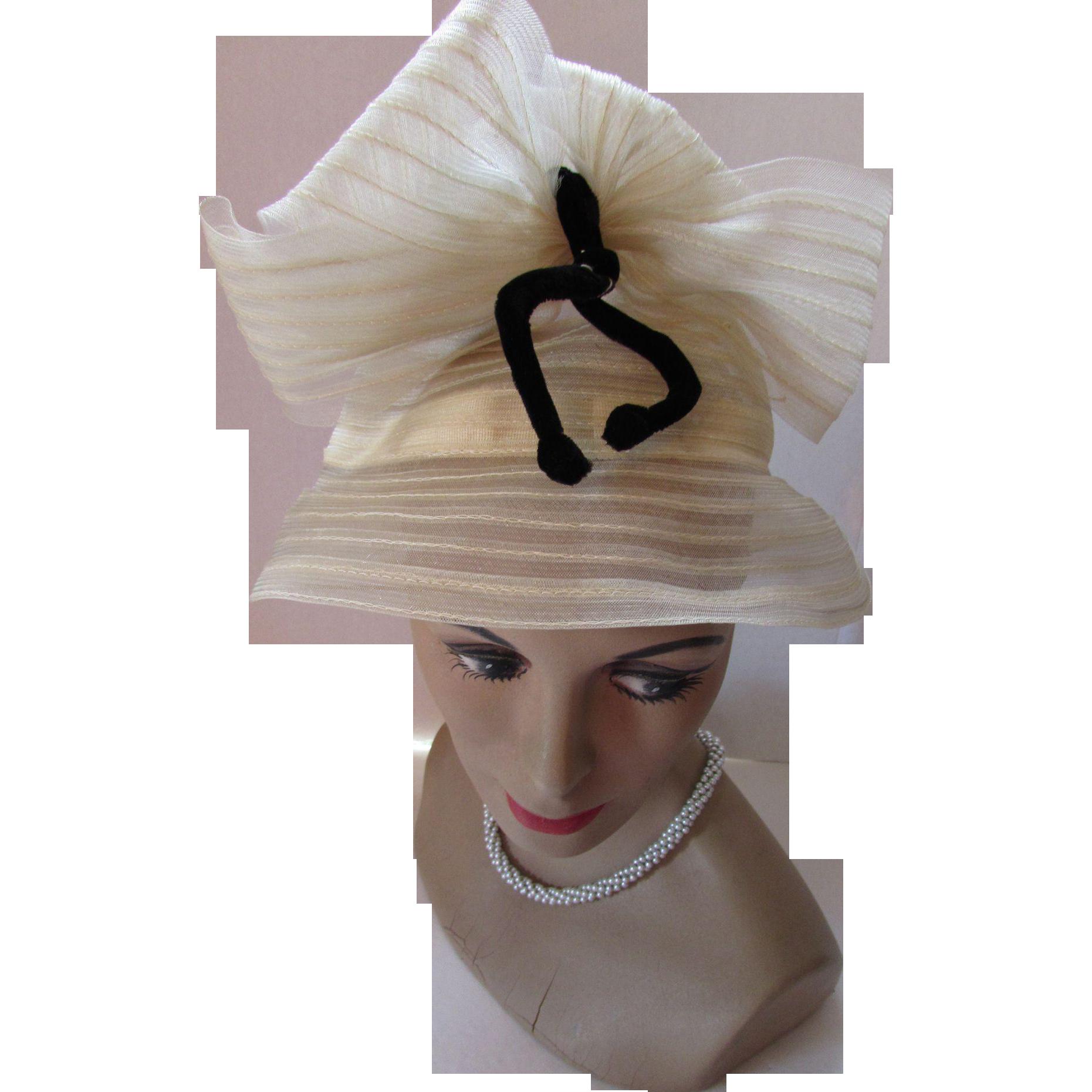 Unusual Sheer Hat in Cream Tone Weave High Crown with Black Velvet Bow