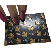 Combination Compact and Lipstick with Black Background and Flower Sprigs