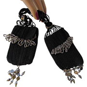 Black Miser Purse in Knit with Silver Tone Rings, Tassels and Charms
