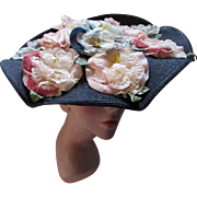 Navy and Wavy Cartwheel Hat with Profusion of Pink Flowers by Lilyan Models