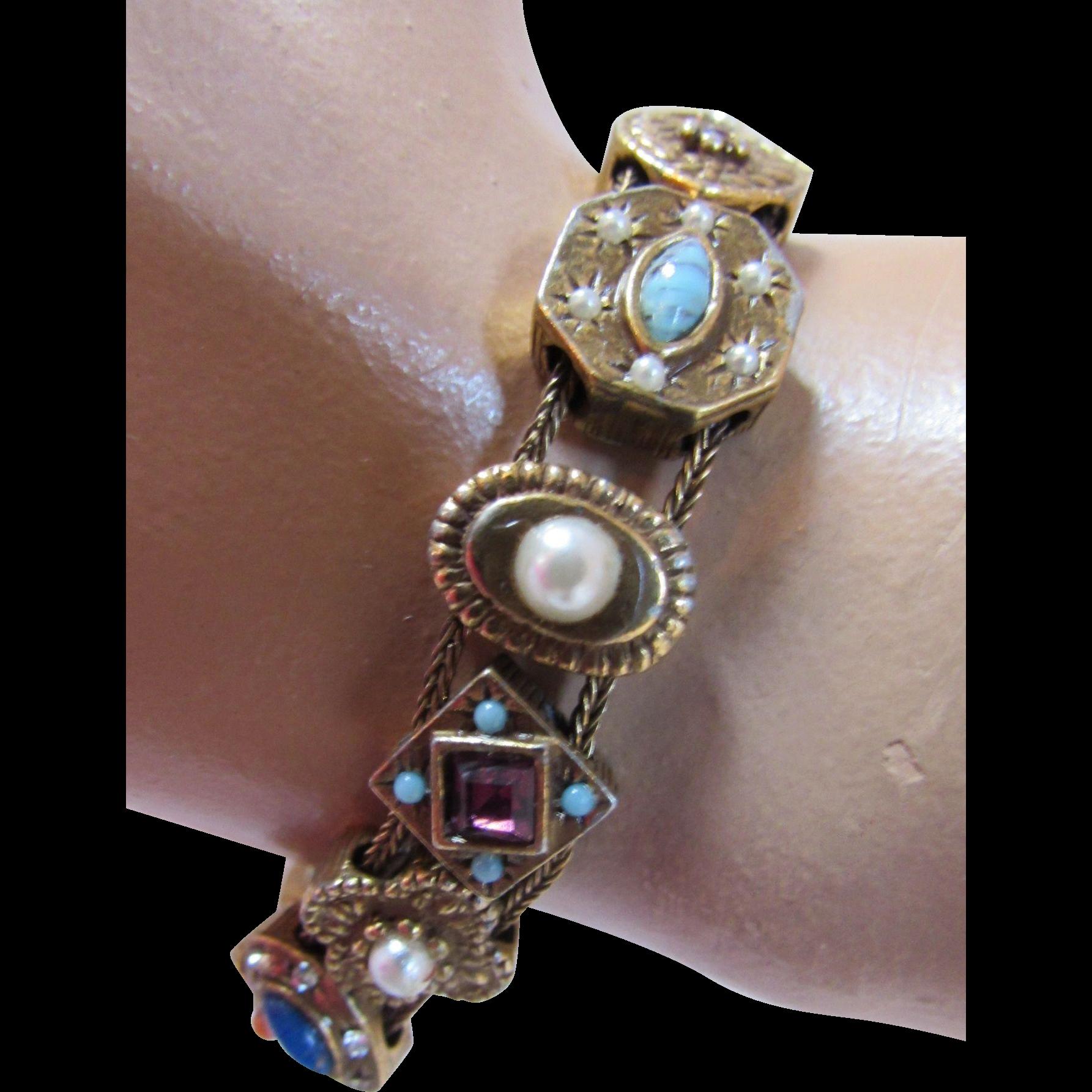 Goldette Slide Bracelet with 14 Links in Varied Themes Mid Century