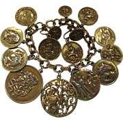 Faux Coin Bracelet and Earrings in Gold Tone Shakespeare Medusa Rampant Lion
