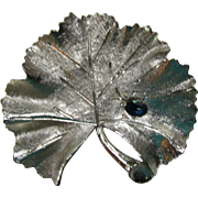 BSK Brooch in Brushed Silver Tone Ginkgo Leaf Single Royal Blue Stone