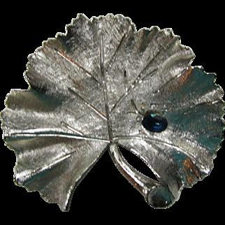BSK Brooch in Brushed Silver Tone Ginkgo Leaf Single Royal Blue Stone