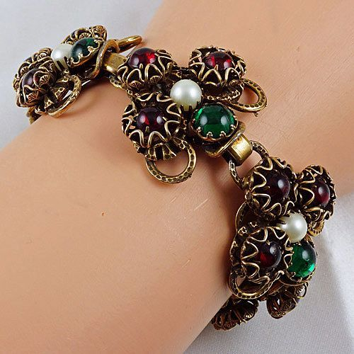 Lovely chunky large & heavier bracelet with fire red and emerald green stones