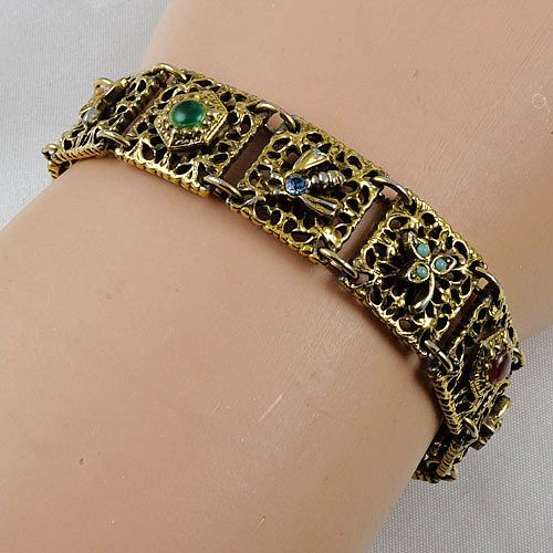 "Designer signed ""Goldette"" bracelet multiple designs in gold tone"